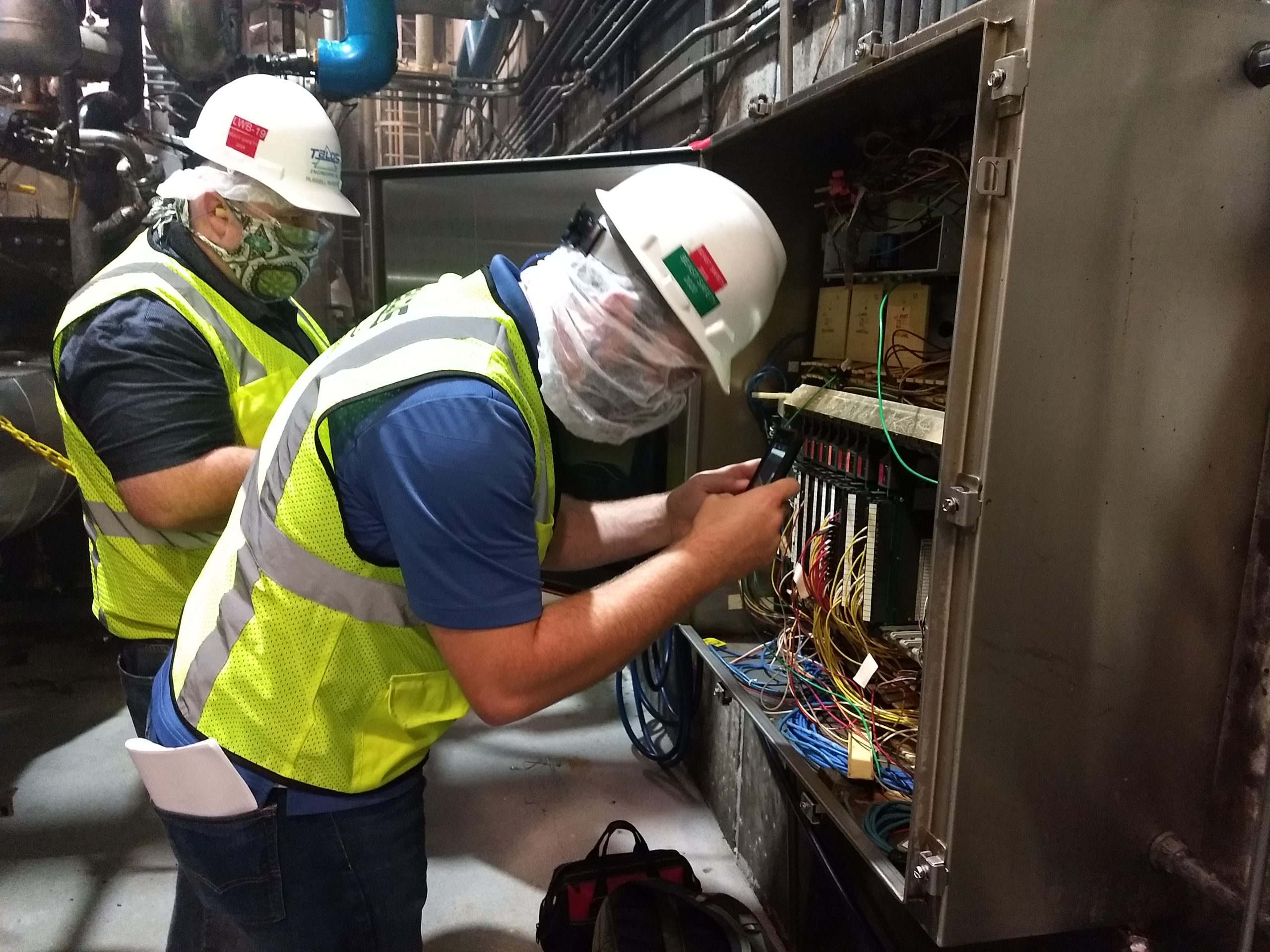 two talos employees working in hard hats